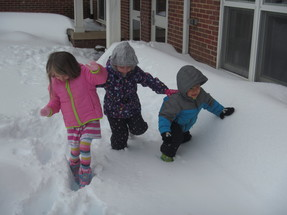 Preschoolers playing in the snow