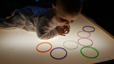 Baby tummy time on light table