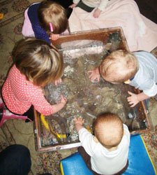 toddlers playing at water table