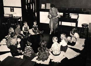 Lucy Brock with children, black and white photo